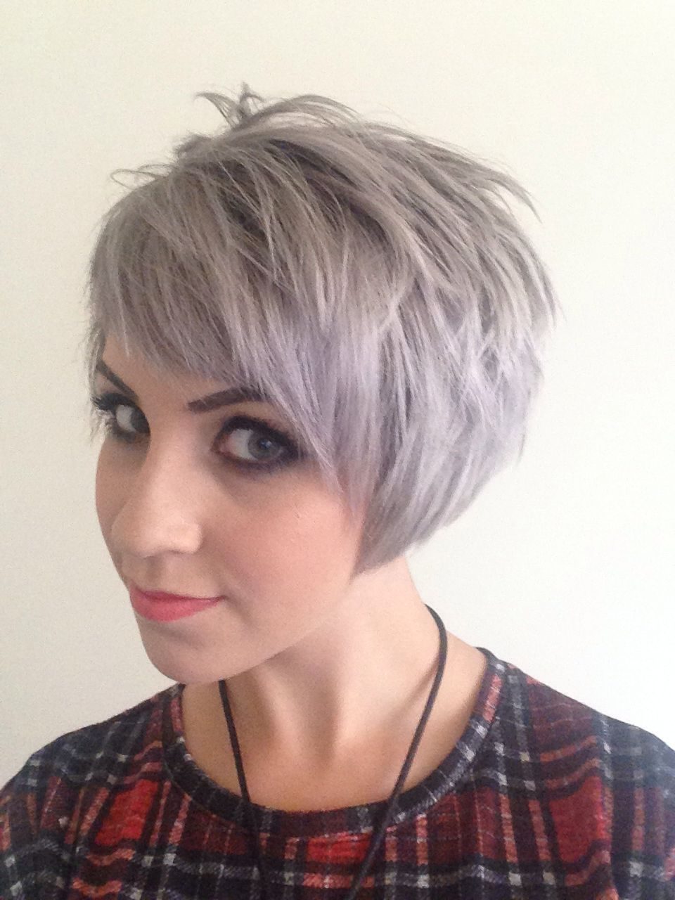 Short Assymetric Undercut Grey Silver Blonde Hair Mac Makeup With Trendy Smokey Pastel Colors Pixie Haircuts (View 14 of 20)