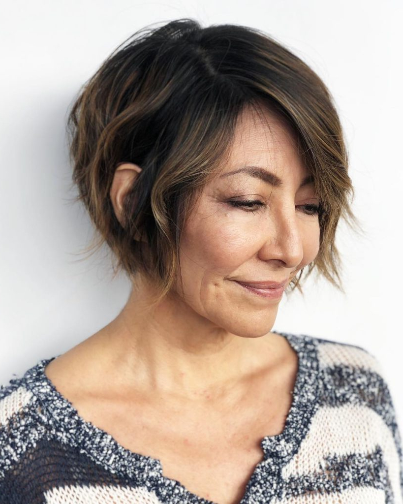Women's Brunette Cropped Bob With Undone Texture And Side Pertaining To Most Recently Released Short Feathered Bob Crop Hairstyles (View 18 of 20)