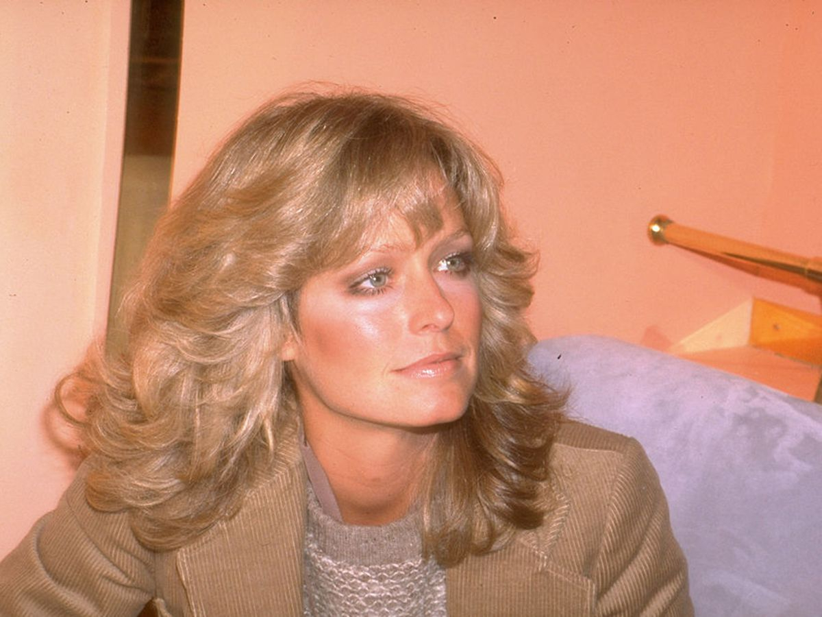 25 Ways To Style '70s Feathered Hair Within Current Long Feather Cut Bangs Hairstyles With Flipped Ends (View 7 of 20)