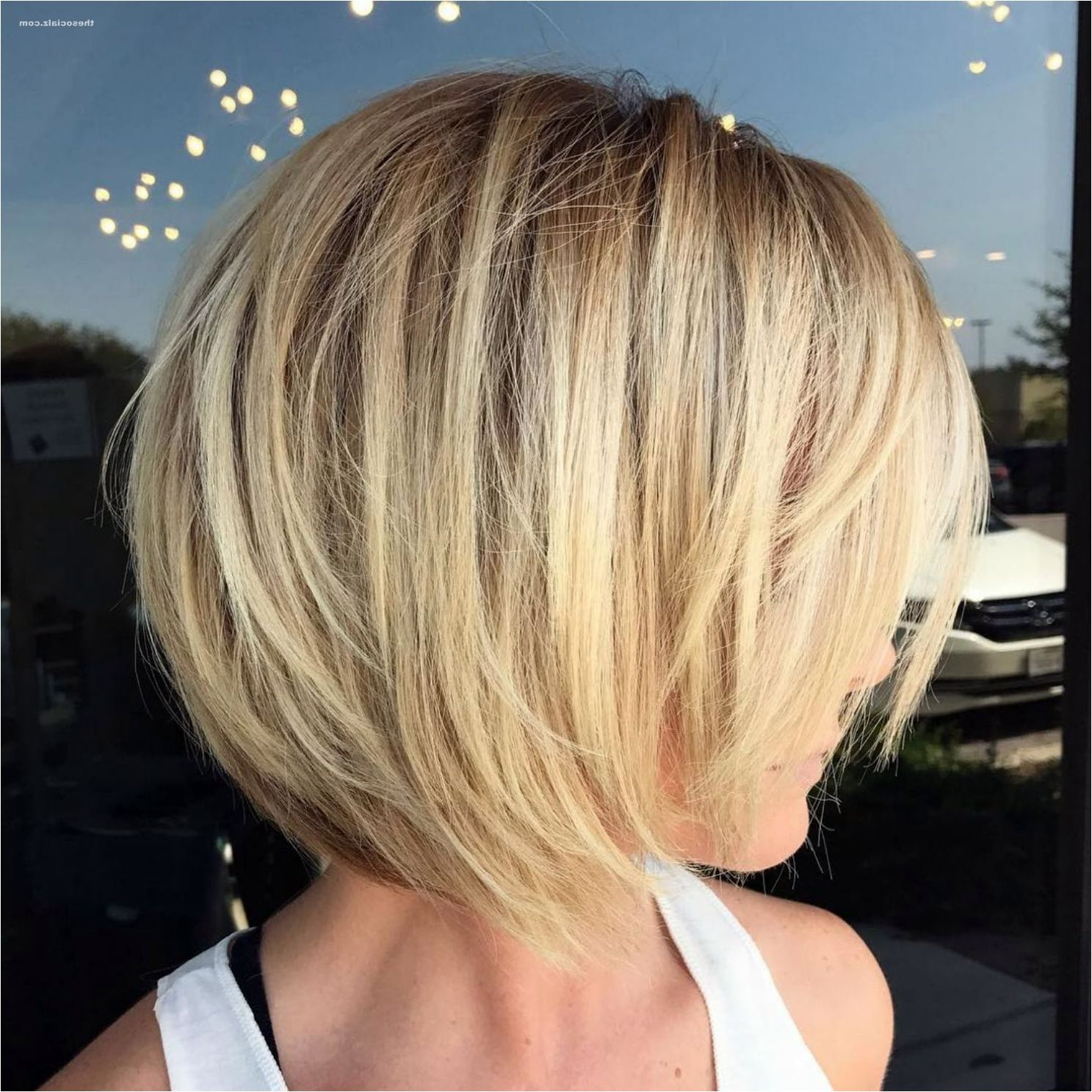 50 Short Layered Bob Haircuts With Side Swept Bangs That Throughout Most Recently Released Dynamic Layered Feathered Bangs Hairstyles (View 8 of 20)