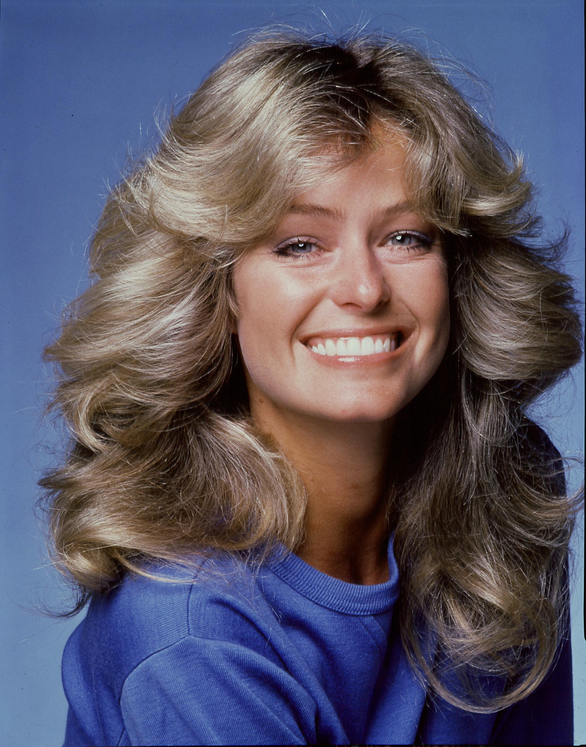 70s Hairstyles: 18 Iconic Hair Trends Making A Comeback With Regard To Trendy Long Feather Cut Bangs Hairstyles With Flipped Ends (View 17 of 20)