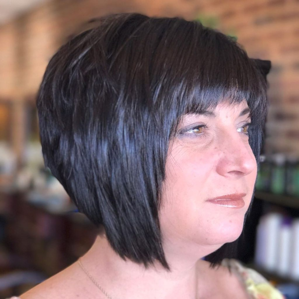 Most Current Feathered Bangs Hairstyles With A Textured Bob With Regard To Short Black Angled Bob With Choppy Layers And Choppy Brow (View 16 of 20)