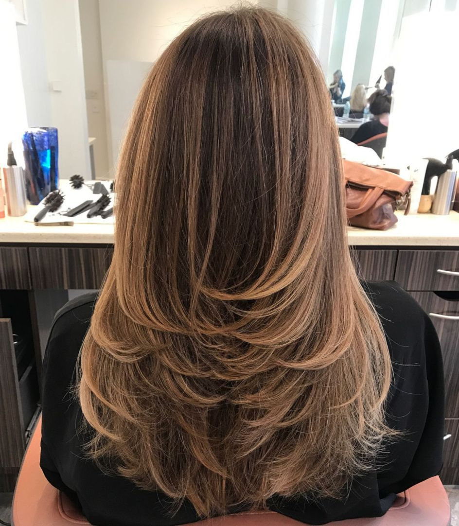 Newest Feathered Bangs Hairstyles With Bright Highlights Inside Long Haircut With Feathered Layers And Highlights (View 7 of 20)