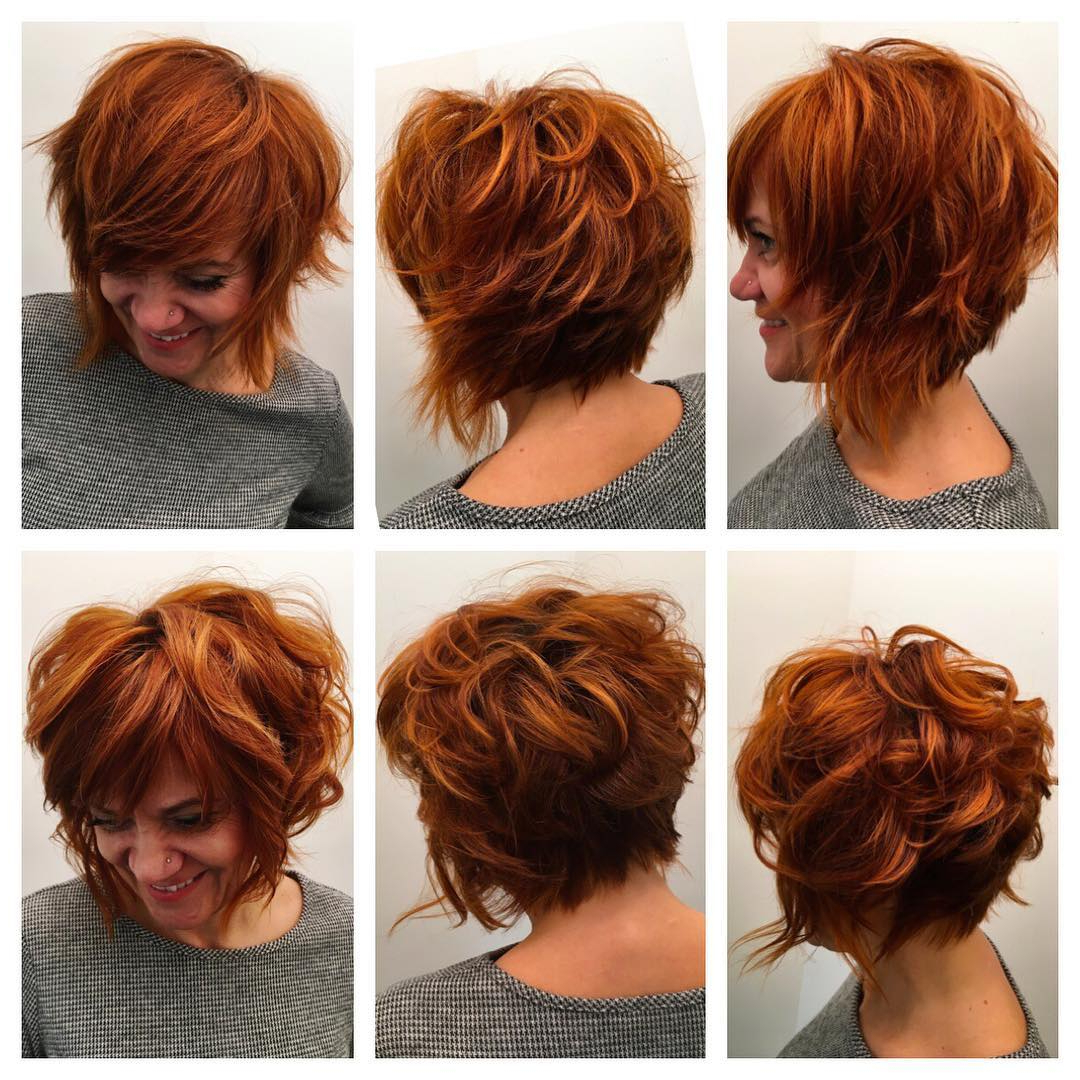 Stacked Angled Bob With Undone Shaggy Texture And Fiery Inside Most Recently Released Asymmetrical Copper Feathered Bangs Hairstyles (View 8 of 20)