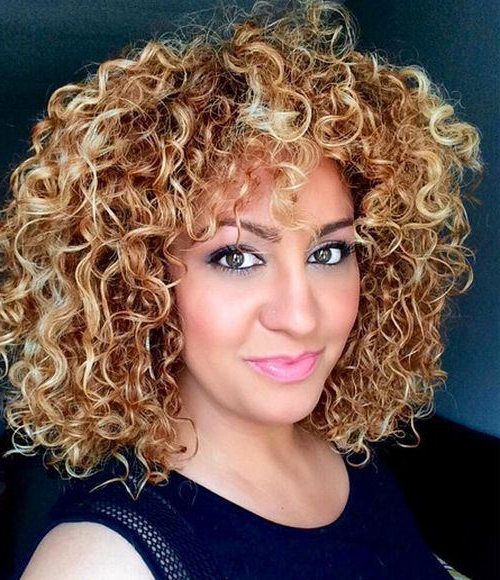 2018 Tight Chocolate Curls Hairstyles With Caramel Touches With 15 Caramel Highlights For Women (View 15 of 20)