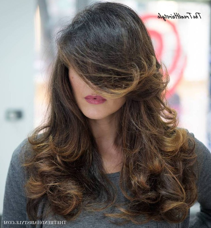 Bouncy Curls And Seductive Bangs – 20 Best Long Hairstyles Intended For Most Current Tight Chocolate Curls Hairstyles With Caramel Touches (View 10 of 20)