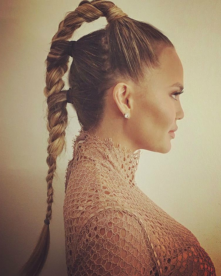 Chrissy Teigen's Futuristic Triple Braided Ponytail Is The With Most Recent Chic Black Braided High Ponytail Hairstyles (View 15 of 20)