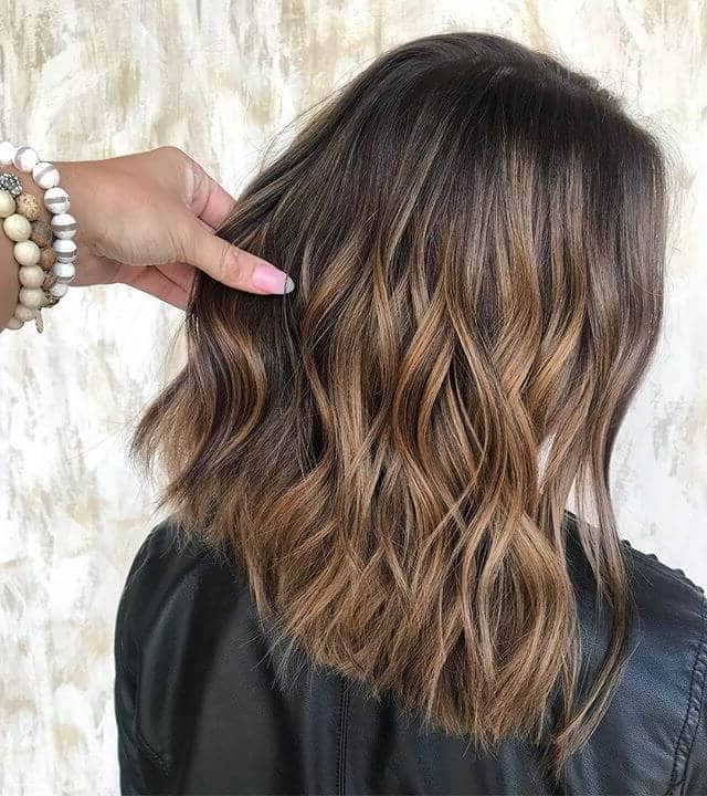 Favorite Tight Chocolate Curls Hairstyles With Caramel Touches Within 45 Stunning Caramel Hair Color Ideas You Need To Try (View 4 of 20)