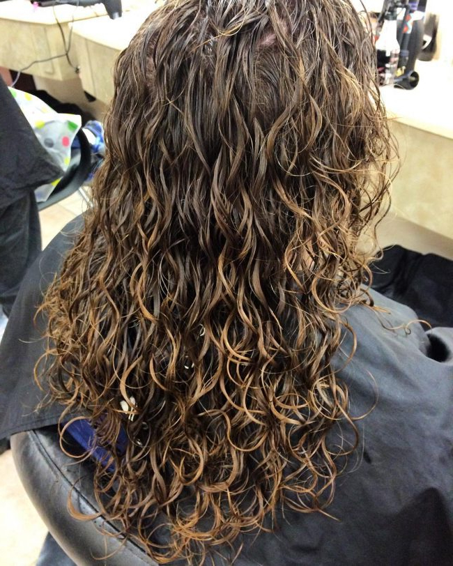Latest Tight Chocolate Curls Hairstyles With Caramel Touches Throughout Spiral Perm Hairstyle Ideas For (View 2 of 20)