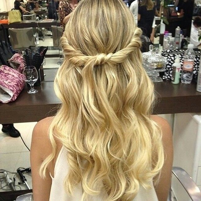 Widely Used Braid Tied Updo Hairstyles Inside Two Twisted Pieces Of Hair From The Front Tied Together In (View 11 of 20)