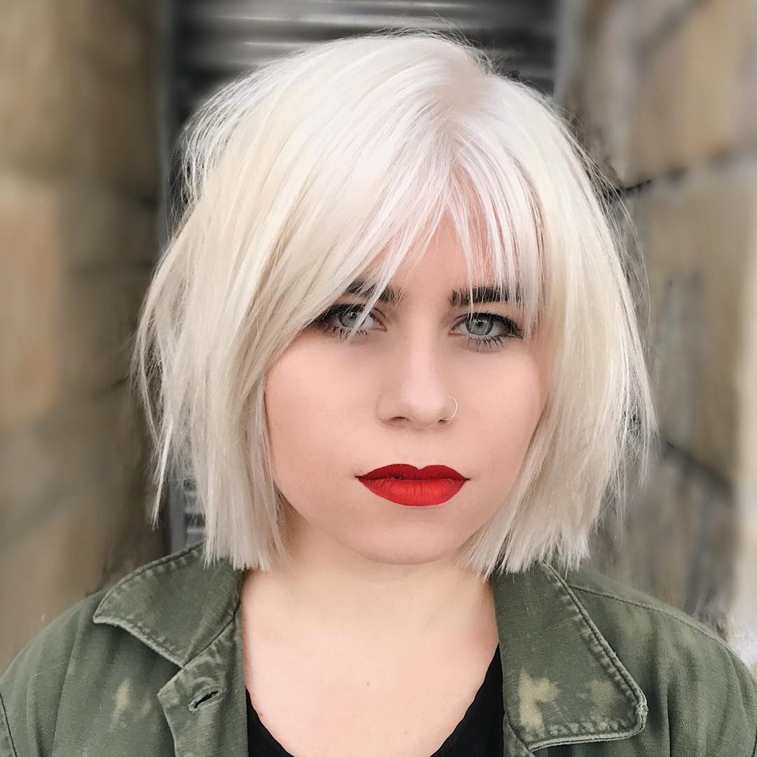 Best And Newest Choppy Layers Hairstyles With Face Framing With Platinum Choppy Bob With Parted Fringe Bangs And Undone (View 10 of 20)