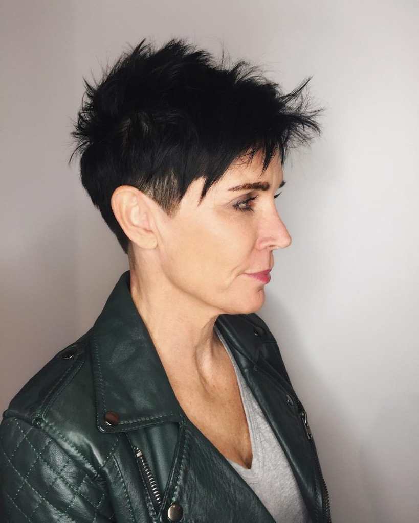 Black Razor Cut Pixie With Spiky Texture And Clean Lines With Regard To Preferred Razor Cut Pink Pixie Hairstyles With Edgy Undercut (View 16 of 20)