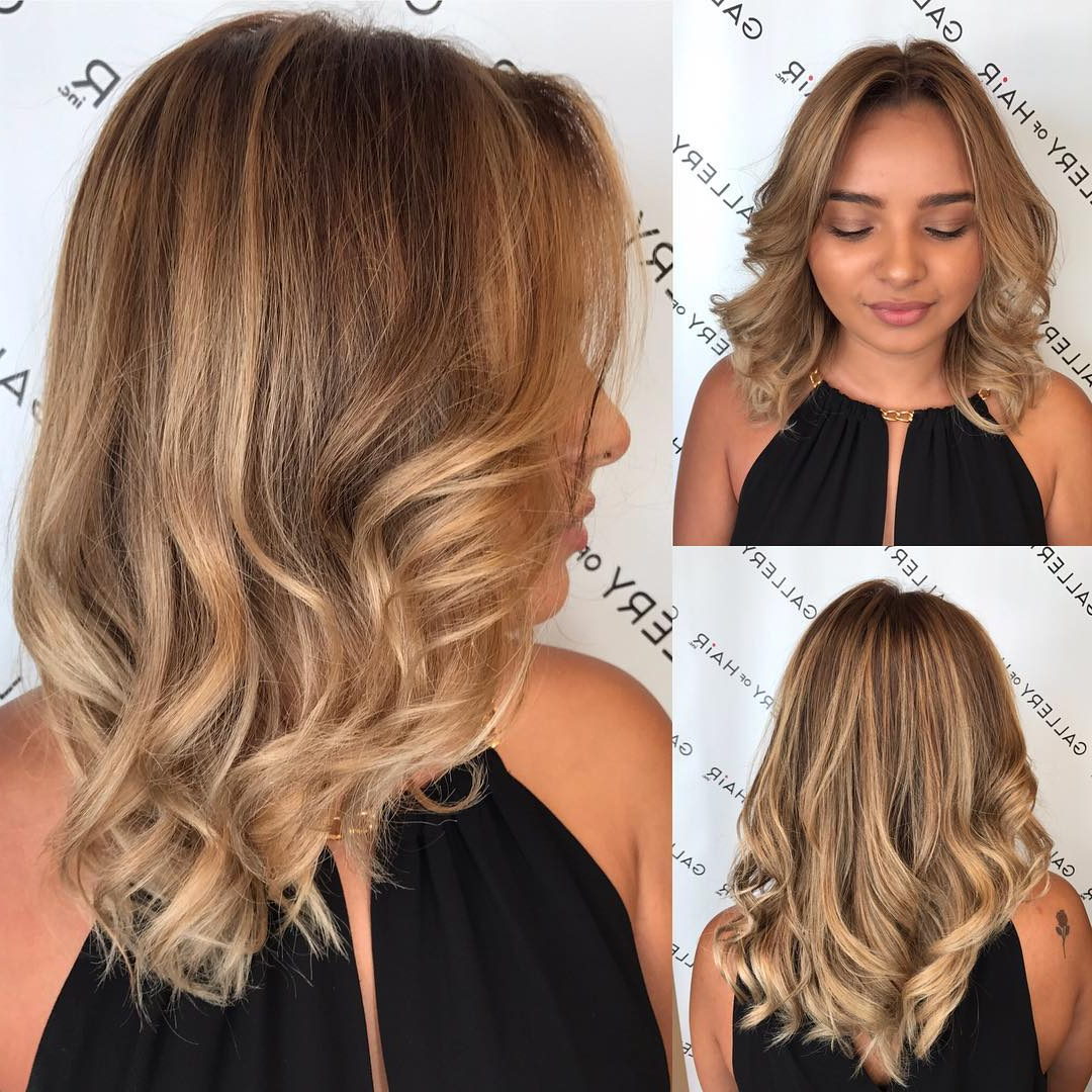 Blonde Sun Kissed Layered Cut With Large Soft Waves And With Regard To Best And Newest Chin Length Bangs And Face Framing Layers Hairstyles (View 17 of 20)