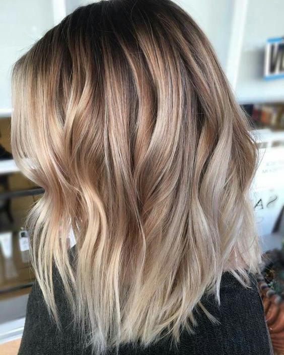 Picture Of Elegant Blonde And Caramel Balayage In Dark With Regard To Natural Looking Dark Blonde Balayage Hairstyles (View 5 of 20)