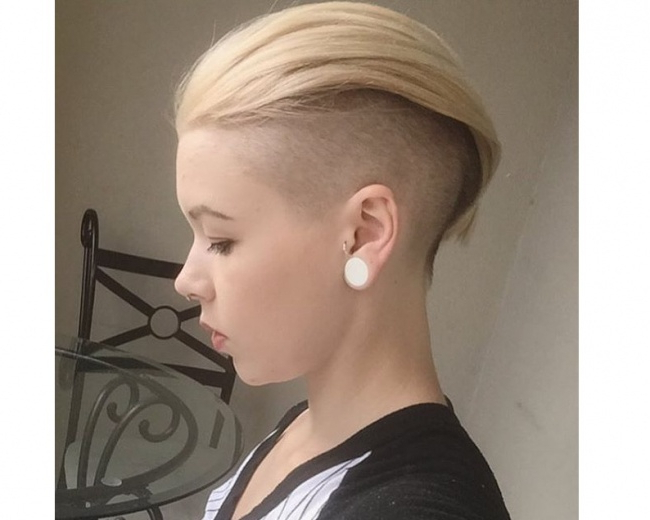 Short, Pixie, Blond Hairstyle With Shaved Sides And Swept Intended For Famous Shaved Sides Pixie Hairstyles (View 14 of 20)