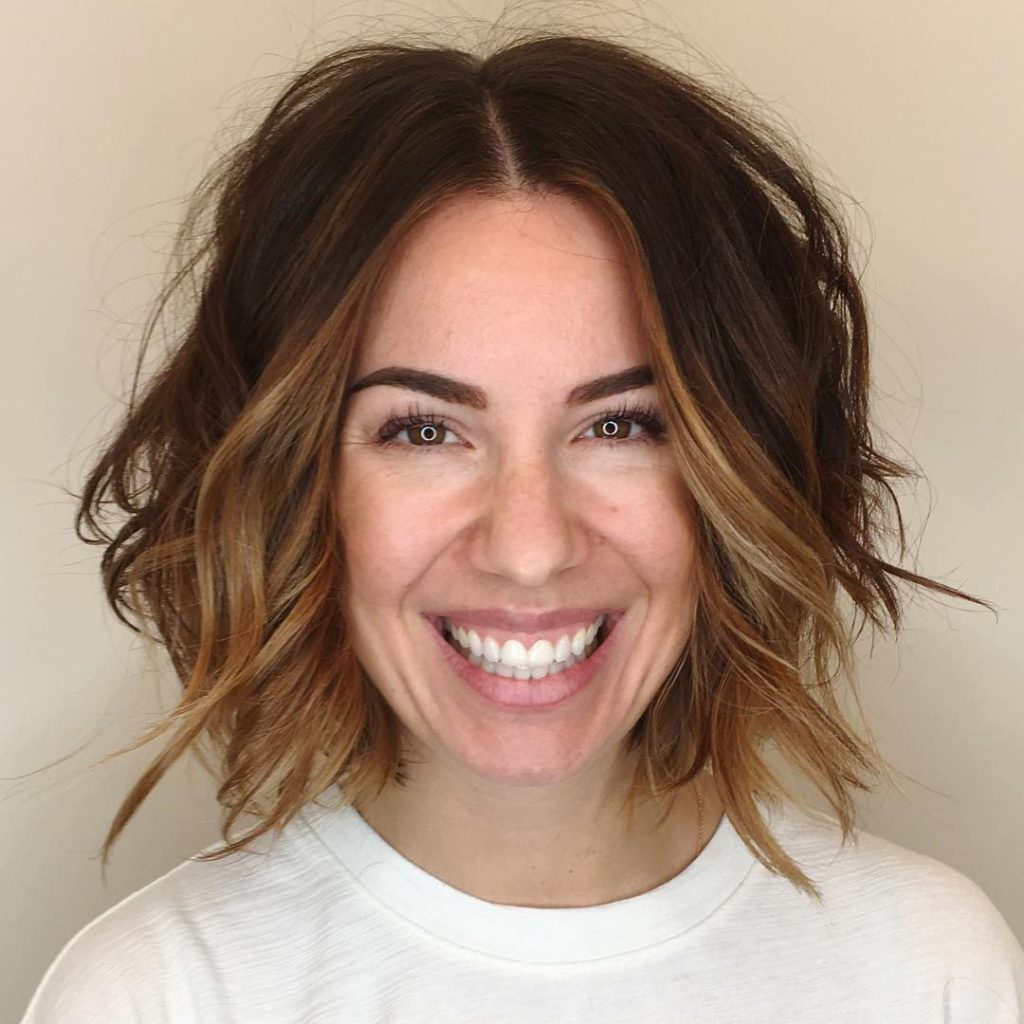 Slightly Angled Soft Layer Bob With Undone Wavy Texture Inside Newest Lob Hairstyles With A Face Framing Fringe (View 18 of 20)