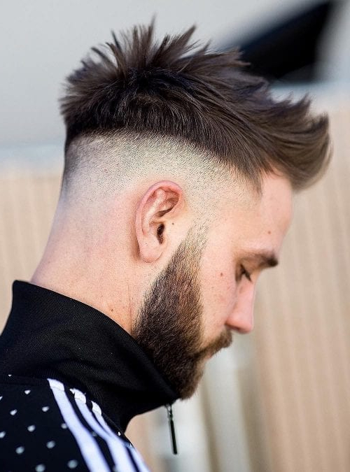 The Undercut Fade: 24 Modern And Classic Variations Of The For Current Contrasting Undercuts With Textured Coif (View 15 of 20)