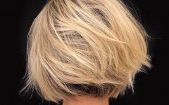 Dynamic Tousled Blonde Bob Hairstyles with Dark Underlayer