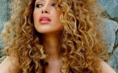 Painted Golden Highlights on Brunette Curls Hairstyles