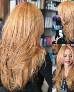 Long Feathered Strawberry Blonde Haircuts