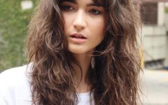 Voluminous Wavy Layered Hairstyles with Bangs