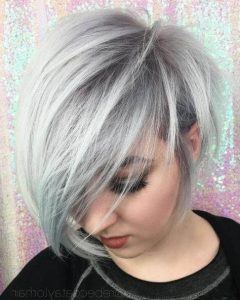 Tapered Pixie Haircuts with Long Bangs