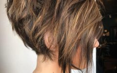 Messy Highlighted Pixie Haircuts with Long Side Bangs