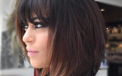 Brunette Feathered Bob Hairstyles with Piece-y Bangs