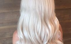 Creamy Blonde Waves with Bangs