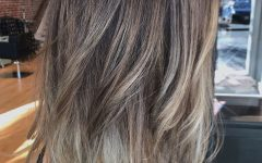 Dark Locks Blonde Hairstyles with Caramel Highlights