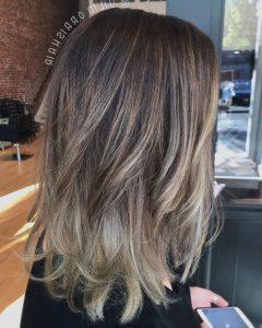 Dark Locks Blonde Hairstyles With Caramel Highlights
