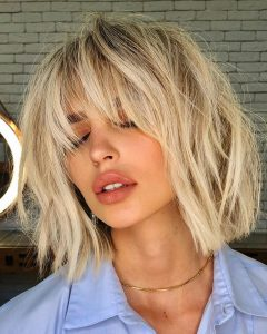 Asymmetrical Copper Feathered Bangs Hairstyles