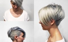 Silver Pixie Haircuts With Side Swept Bangs