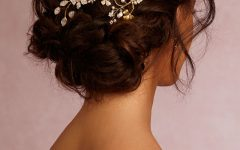 Wavy Low Bun Bridal Hairstyles with Hair Accessory