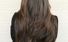 Waist-length Brunette Hairstyles with Textured Layers