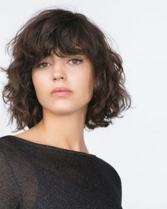 Side Swept Curls and Draped Bangs Hairstyles