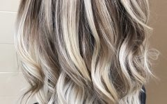 Dark Blonde Hairstyles with Icy Streaks