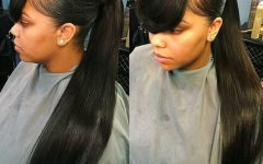 Sleek Pony Hairstyles with Thick Side Bangs