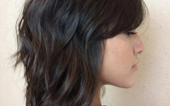 Brunette Wavy Razored Shag Haircuts