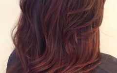 Dimensional Dark Roots to Red Ends Balayage Hairstyles