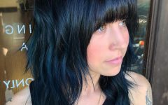 Blue Black Shag Haircuts with Arched Bangs