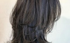 Long Black Haircuts with Light Flipped Up Ends