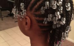 Cornrows with Artistic Beaded Twisted Bun