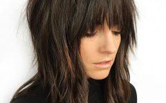 Razored Black Shag Haircuts with Bangs