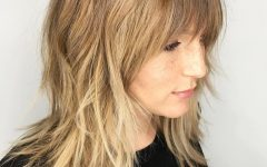 Shoulder-length Feathered Hairstyles with Bangs