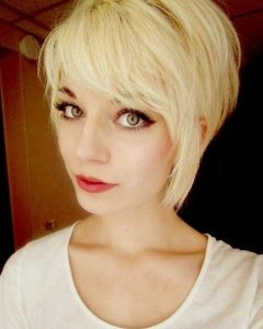 Pixie Haircuts With Long Side Swept Bangs